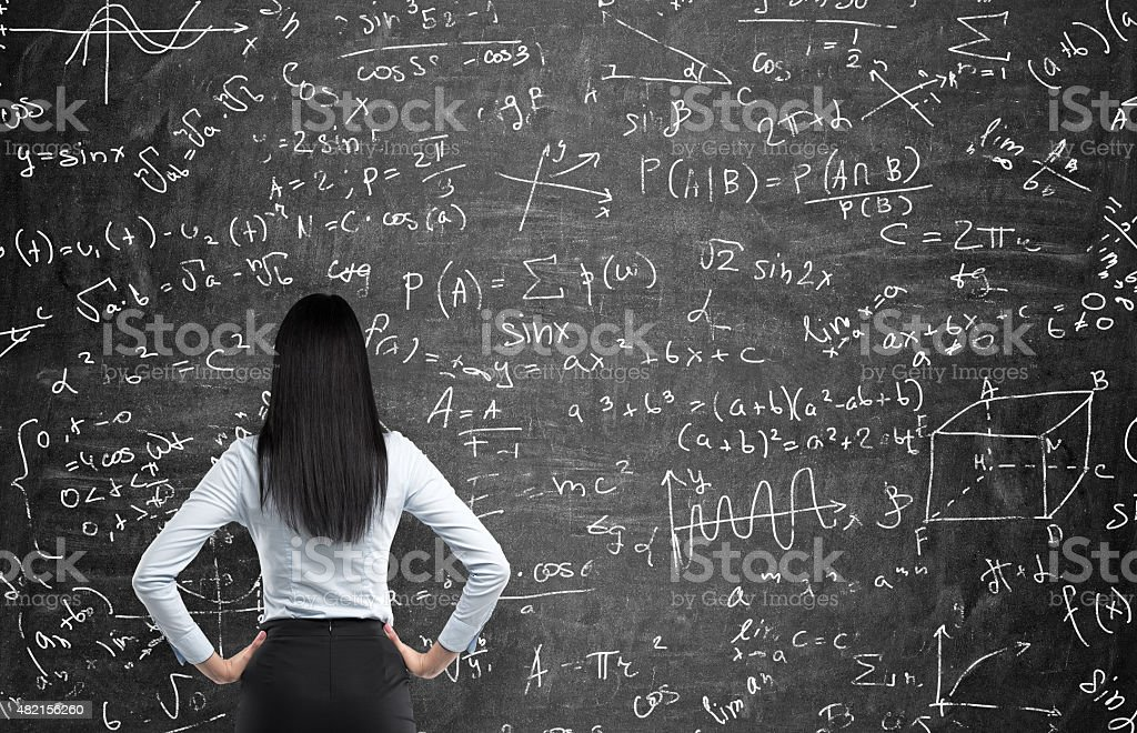 woman who tries to solve math problems. stock photo