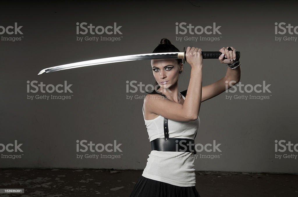 Woman Wielding Ceremonial Sword stock photo