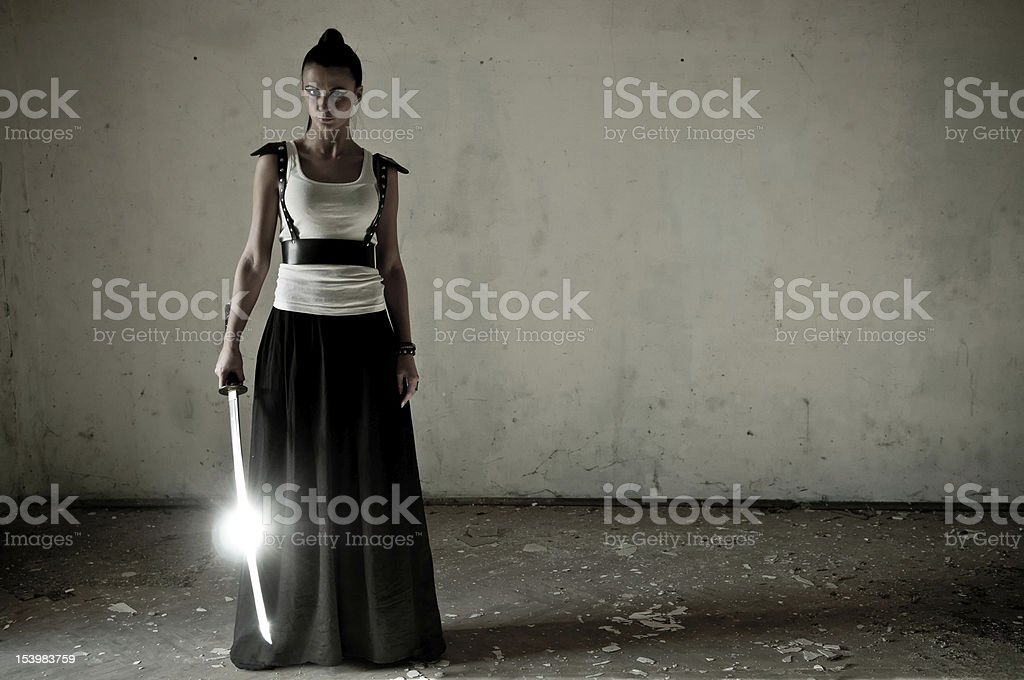 Woman Wielding katana stock photo