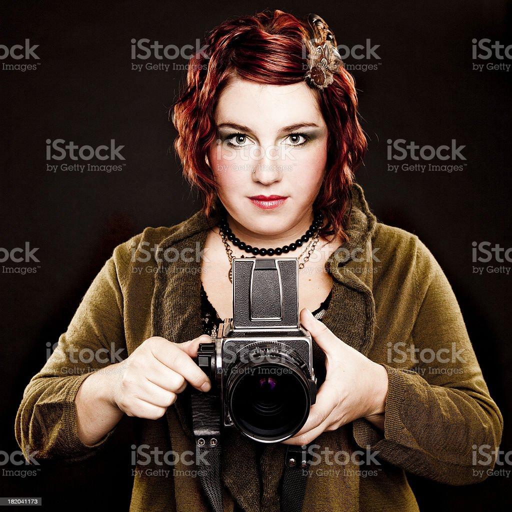 Woman Winding a Vintage Camera stock photo