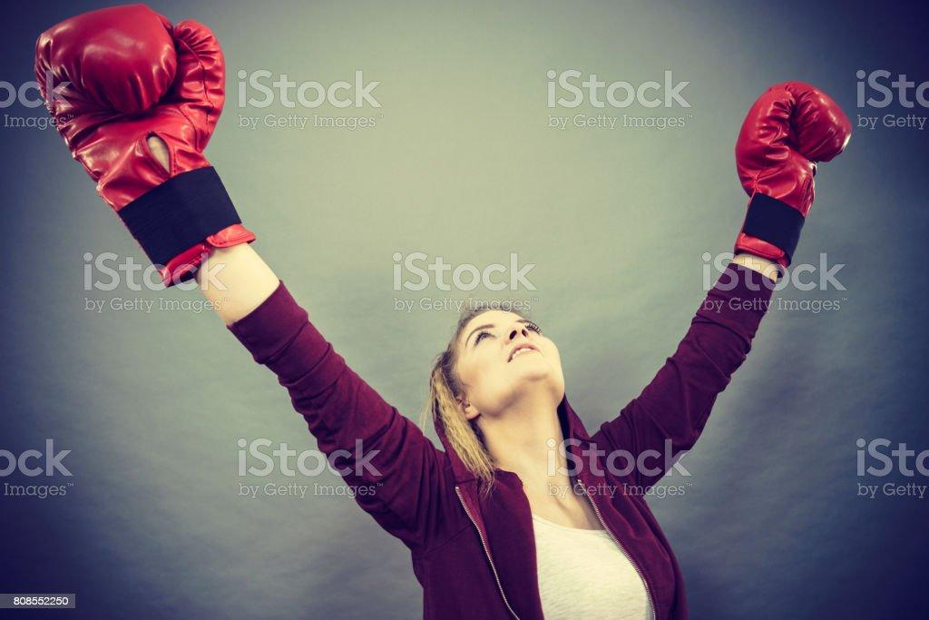 Woman winner wearing boxing gloves stock photo