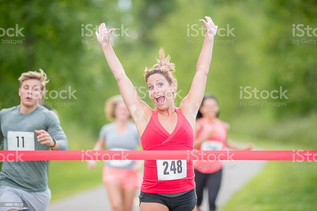 Woman Winning a Race stock photo
