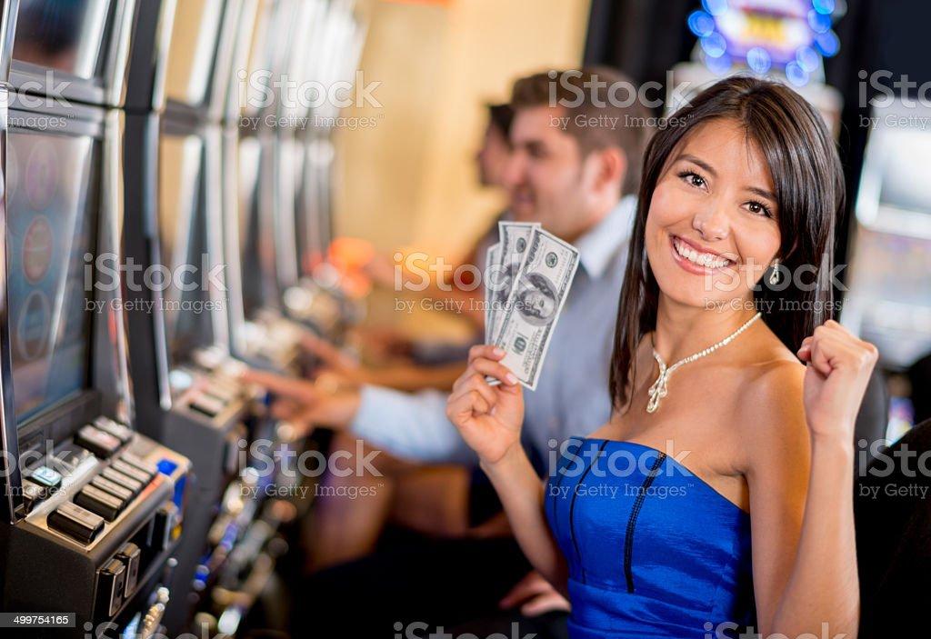 Woman winning at the casino stock photo