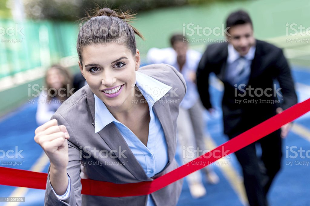 Woman winning business race stock photo