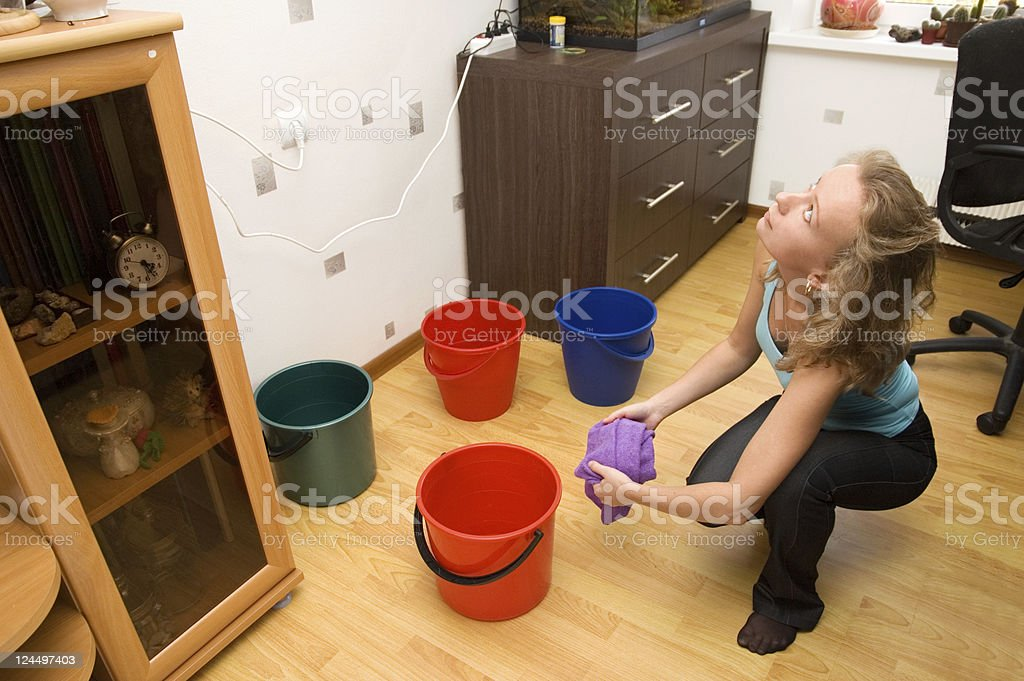 Woman wiping floor after flood royalty-free stock photo