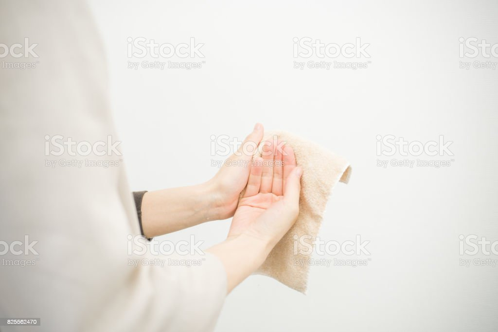 Woman wiping with a handkerchief stock photo
