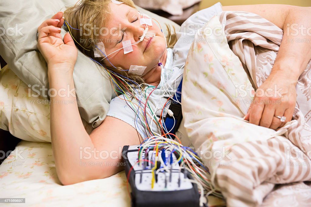 Woman wired for sleep study stock photo