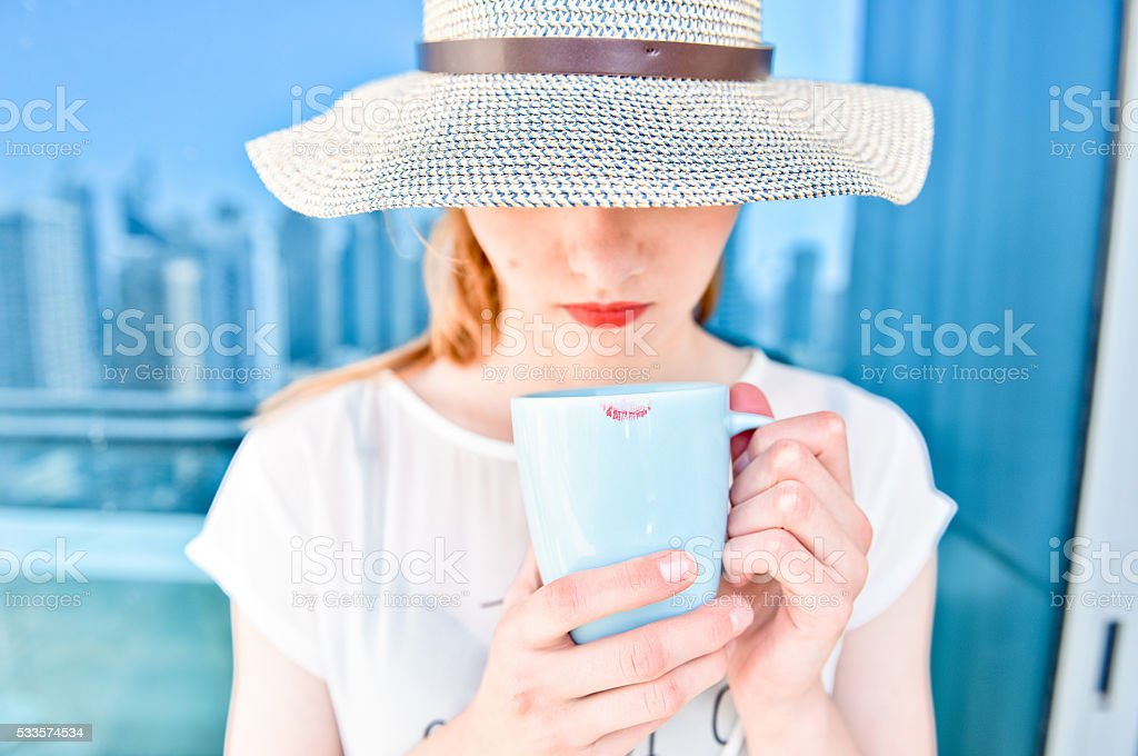 Woman wit cup of hot drinks stock photo