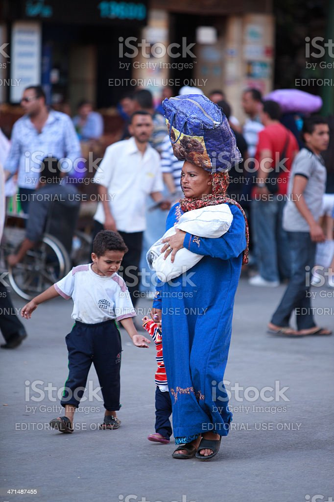 Woman with 3 children in Cairo stock photo