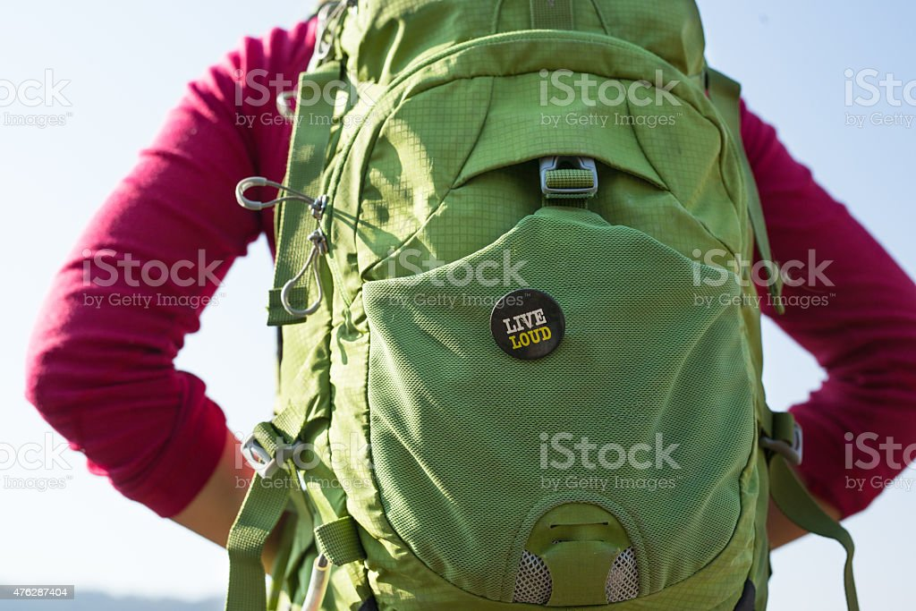 Woman with a backpack rear closeup stock photo