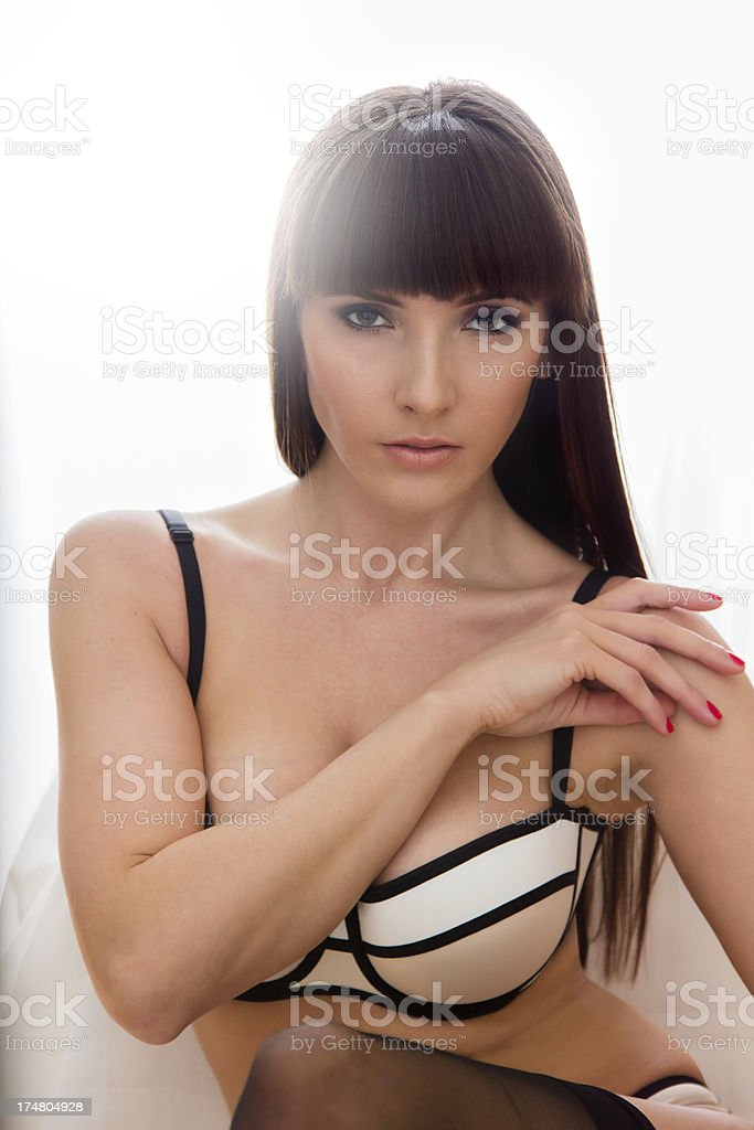 A woman with a black hair posing for a glamour photo session royalty-free stock photo