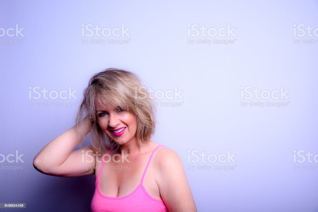 A Woman With A Blonde Bob Hairstyle stock photo