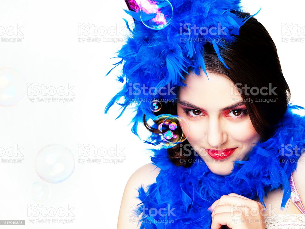 Woman with a blue feather boa stock photo