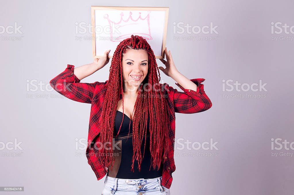 Woman with a board over her head with crown drawn. stock photo