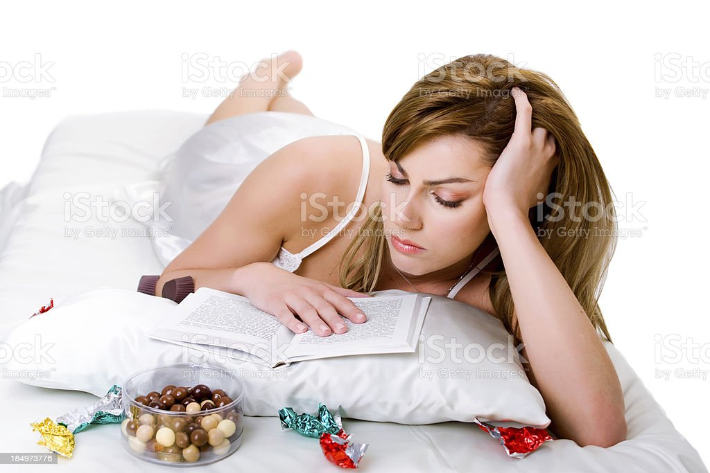 Woman with a book and sweets royalty-free stock photo
