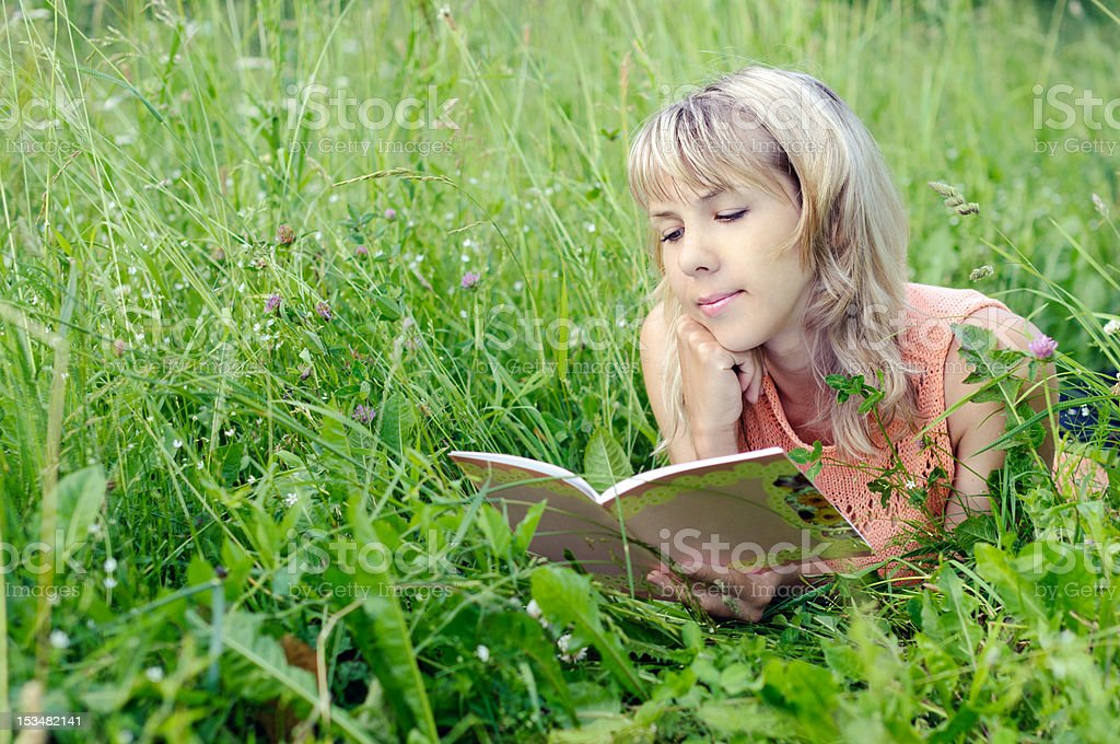 woman with a book royalty-free stock photo