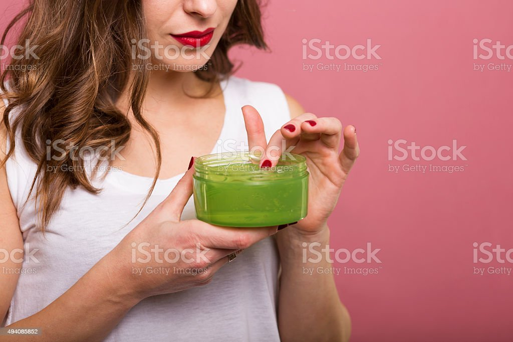 Woman with a bottle of cream stock photo