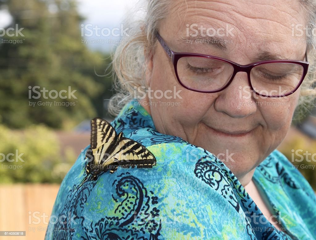 Woman With A Butterfly On Her Shoulder stock photo