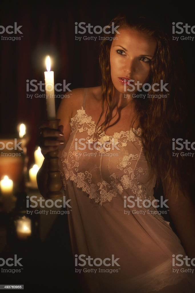 Woman with a candle stock photo