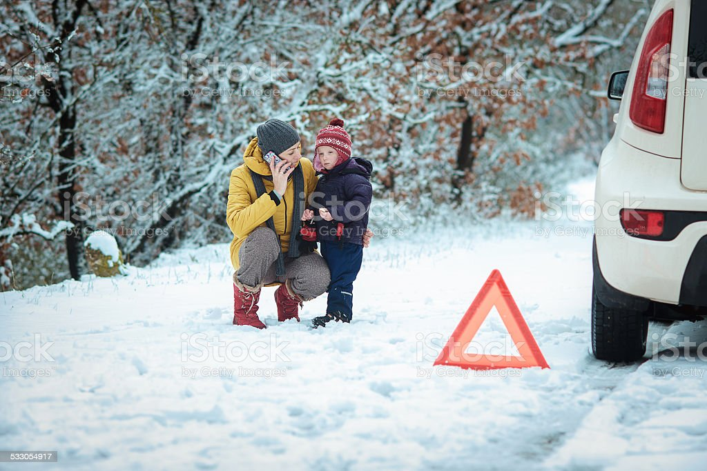 woman with a child on the winter road. stock photo