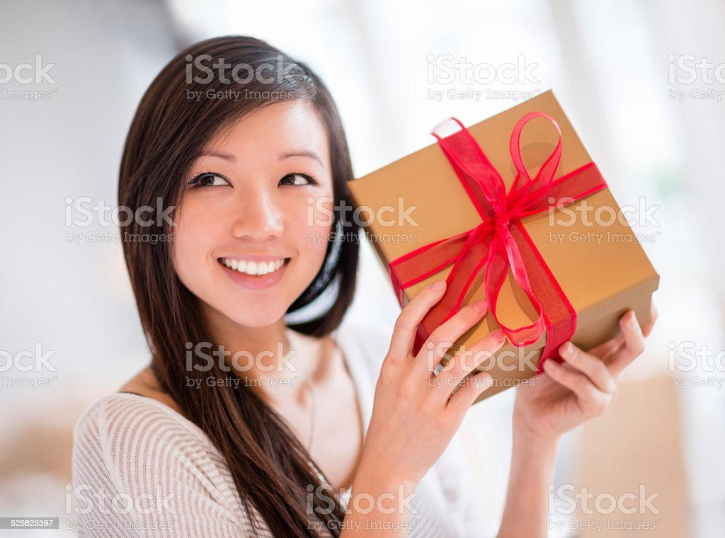 Woman with a Christmas gift stock photo