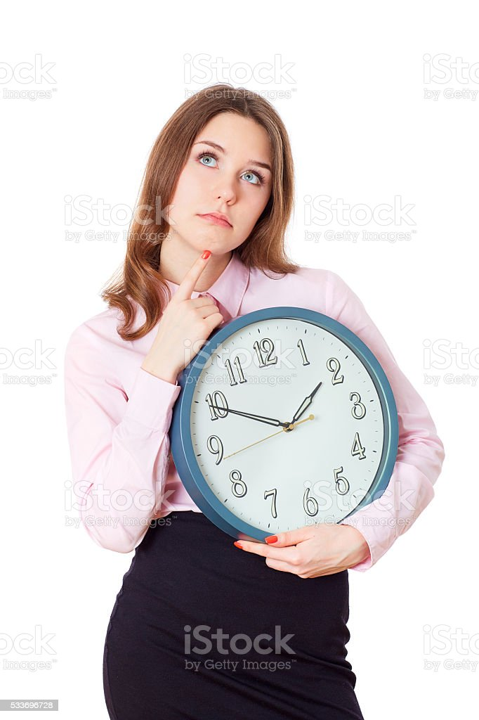 Woman with a clock in his hands thinking. stock photo