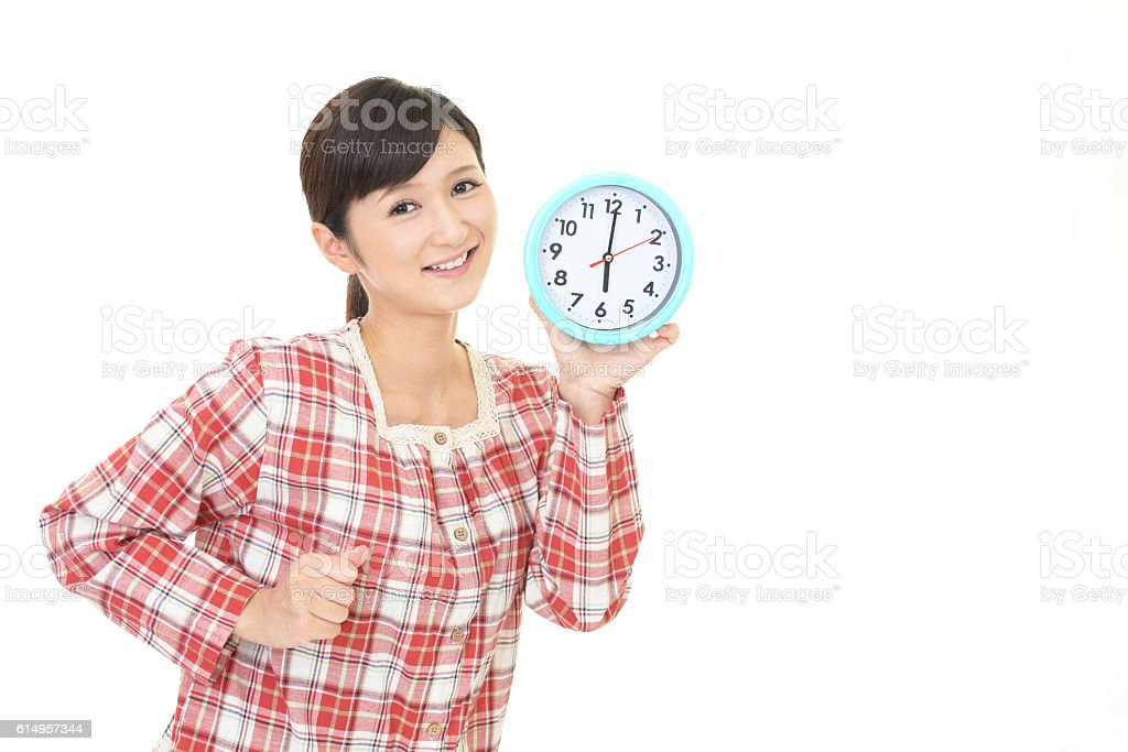 Woman with a clock stock photo