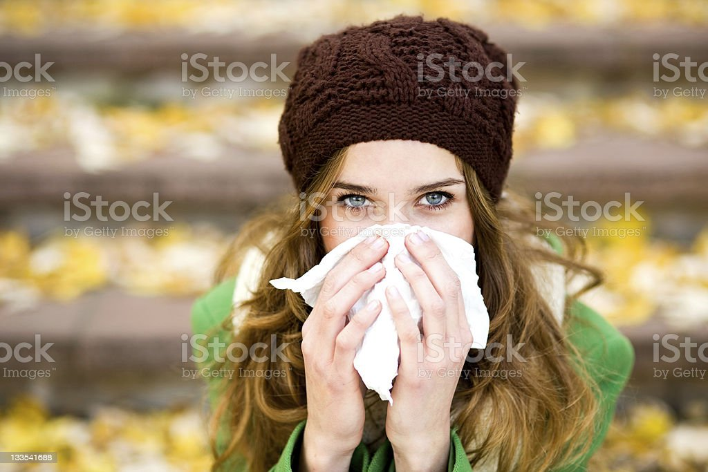 Woman with a cold stock photo