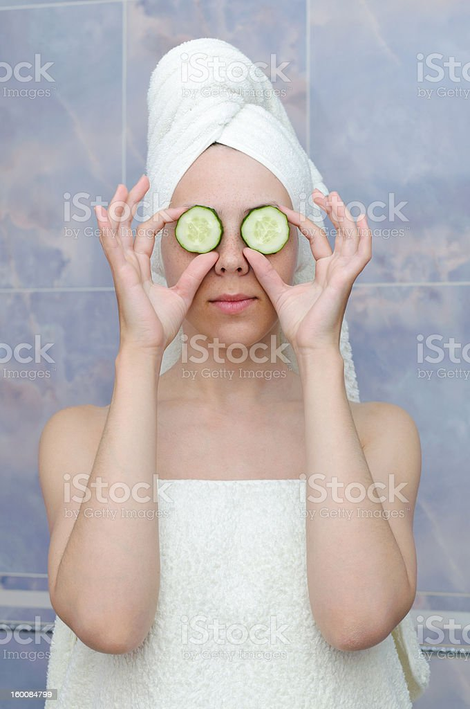 woman with a cucumbers on eyes royalty-free stock photo