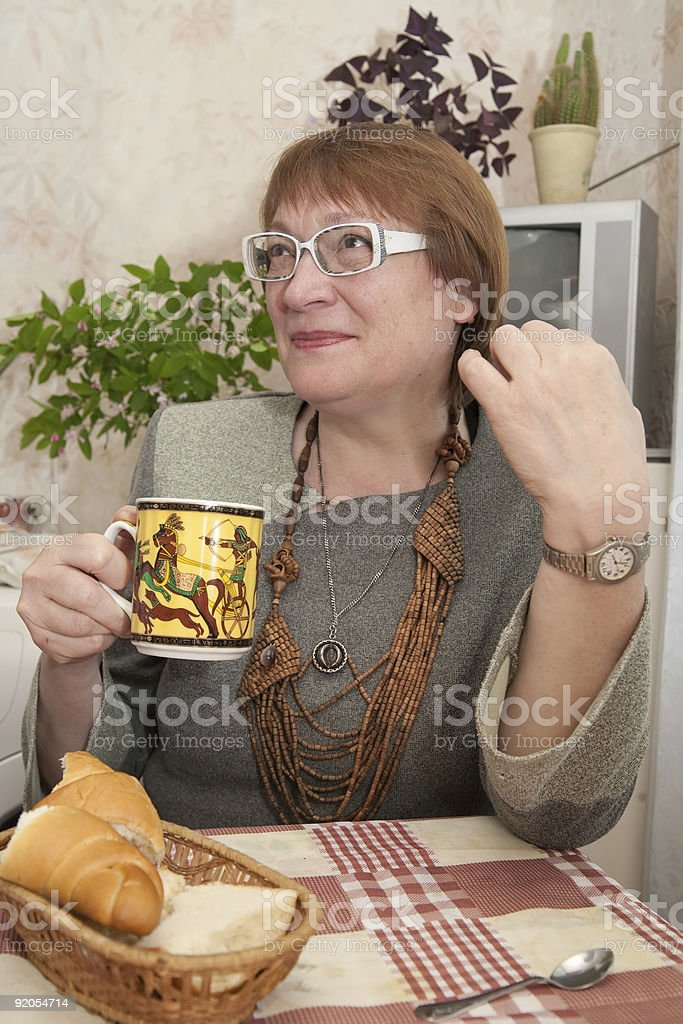 woman with a cup  in the kitchen royalty-free stock photo