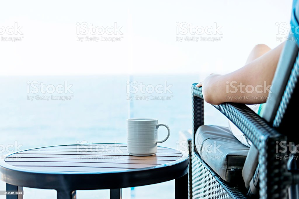 Woman with a cup on cruise ship stock photo