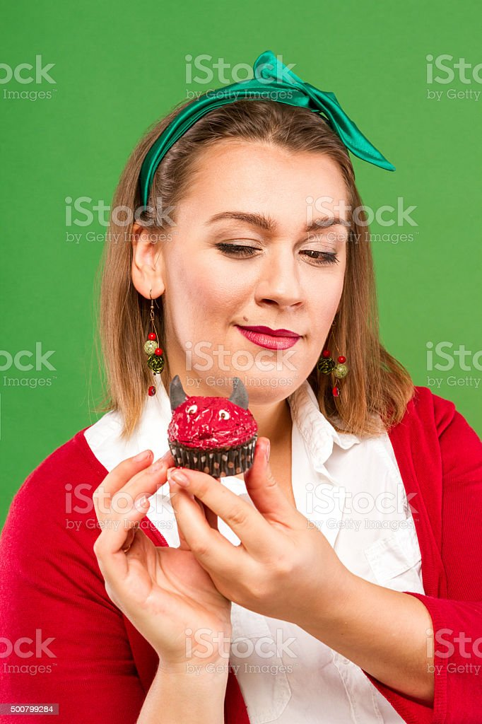 Woman with a cupcake royalty-free stock photo