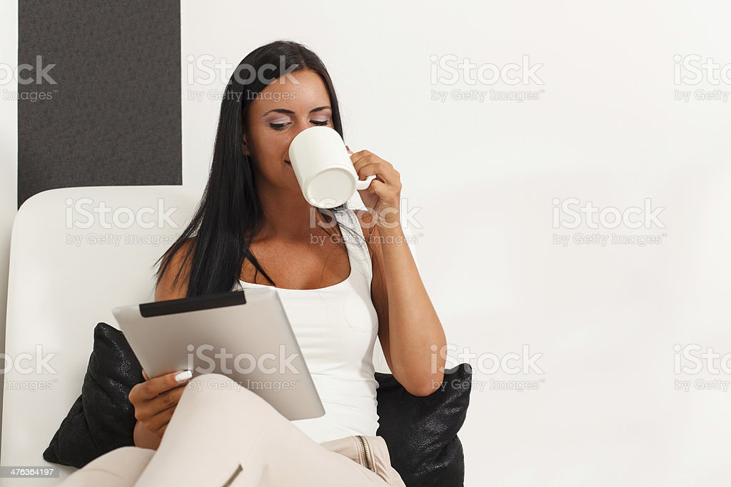 Woman with a digital tablet at home royalty-free stock photo