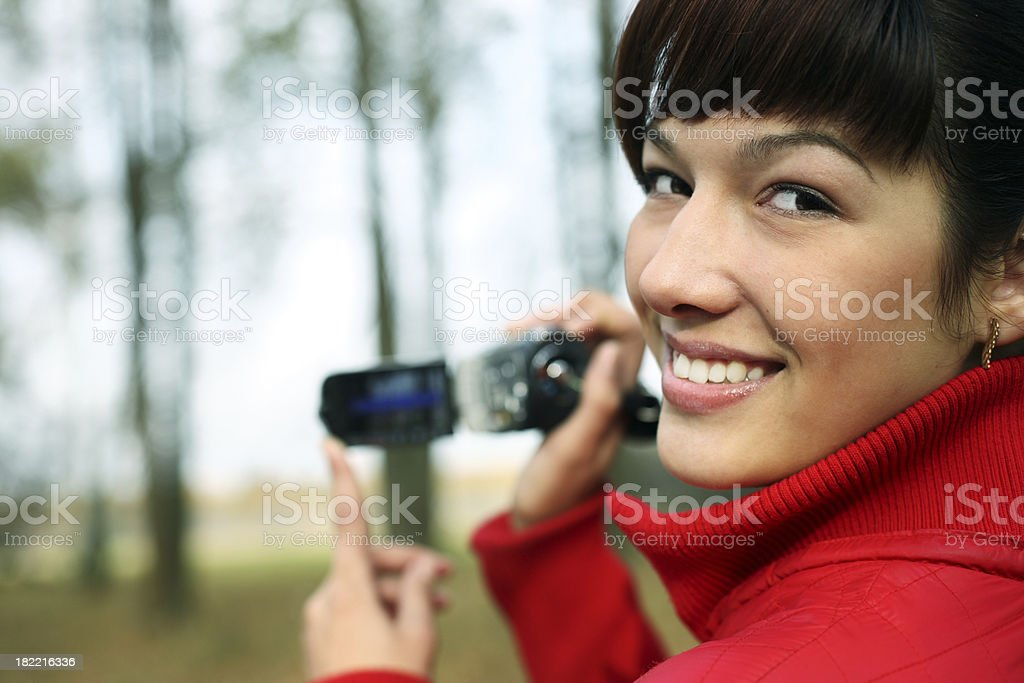 woman with a digital video camera stock photo