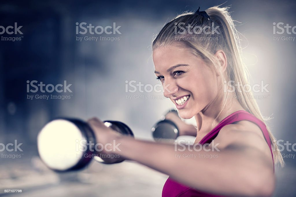Woman with a dumbbell stock photo
