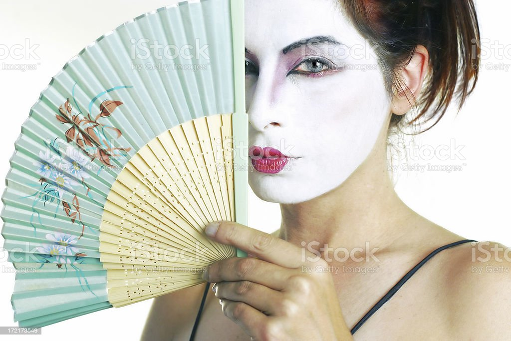 Woman with a fan and white face paint royalty-free stock photo