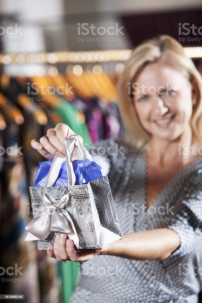 Woman with a gift bag stock photo