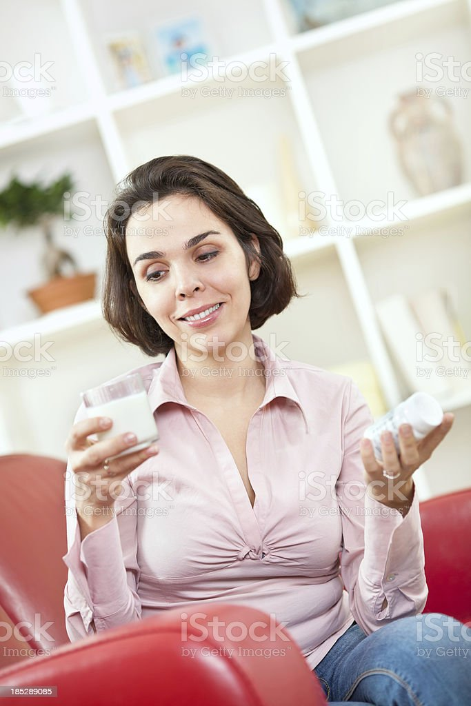Woman with a glass of milk royalty-free stock photo
