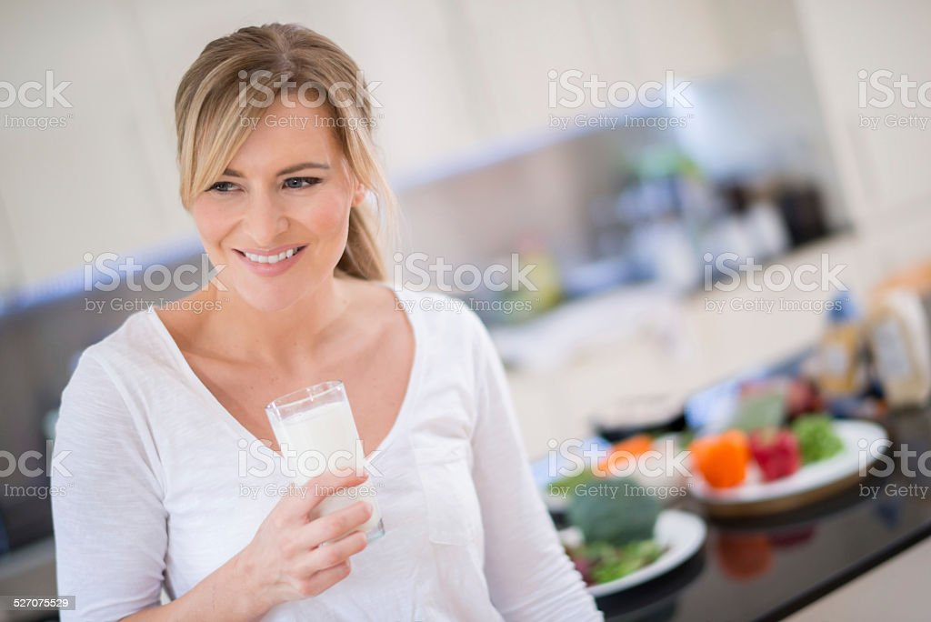 Woman with a glass of milk stock photo