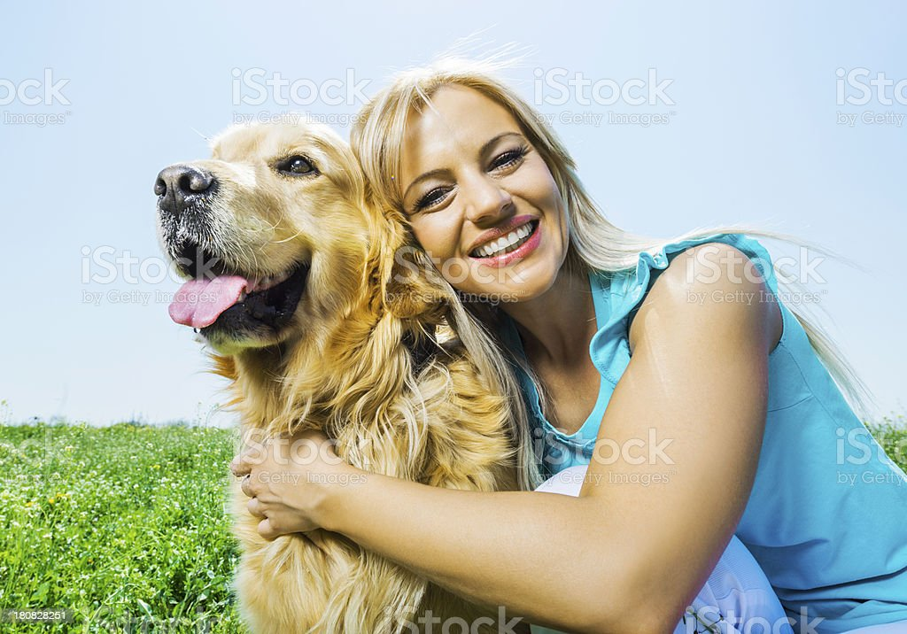 Woman with a golden retriever. stock photo
