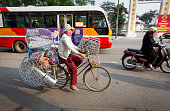 Woman with a hardware shop on a bike