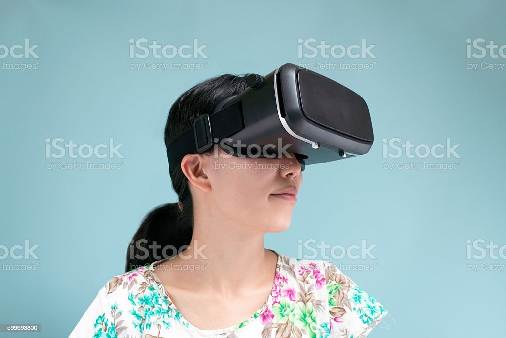 Woman with a head mounted display stock photo