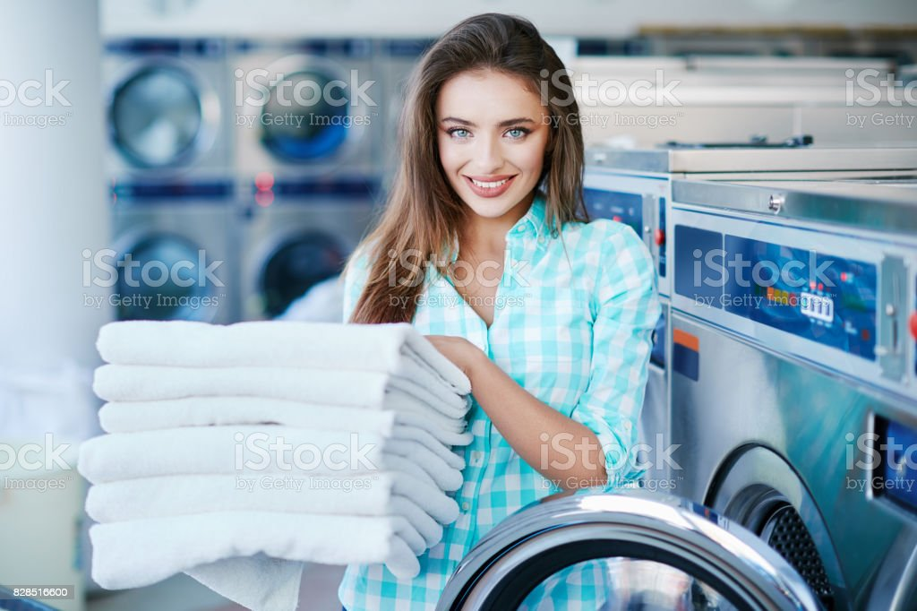 Woman with a heap of linen stock photo