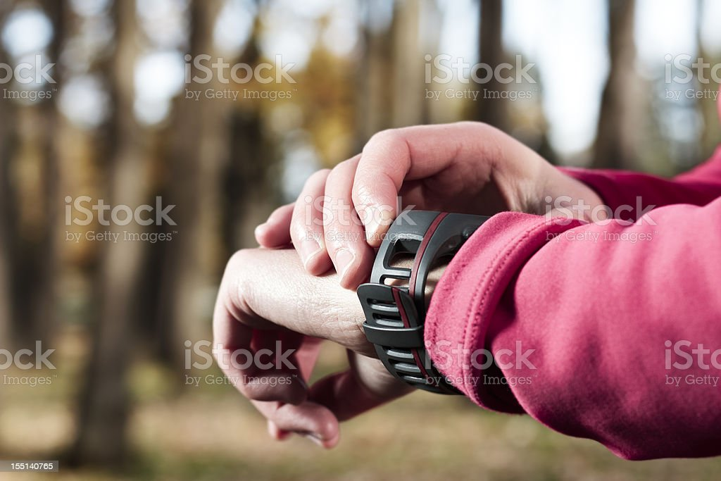 Woman with a heart rate monitor watch. royalty-free stock photo