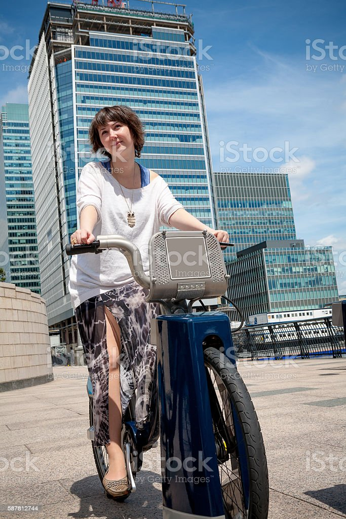 Woman with a hire bike. London, England stock photo