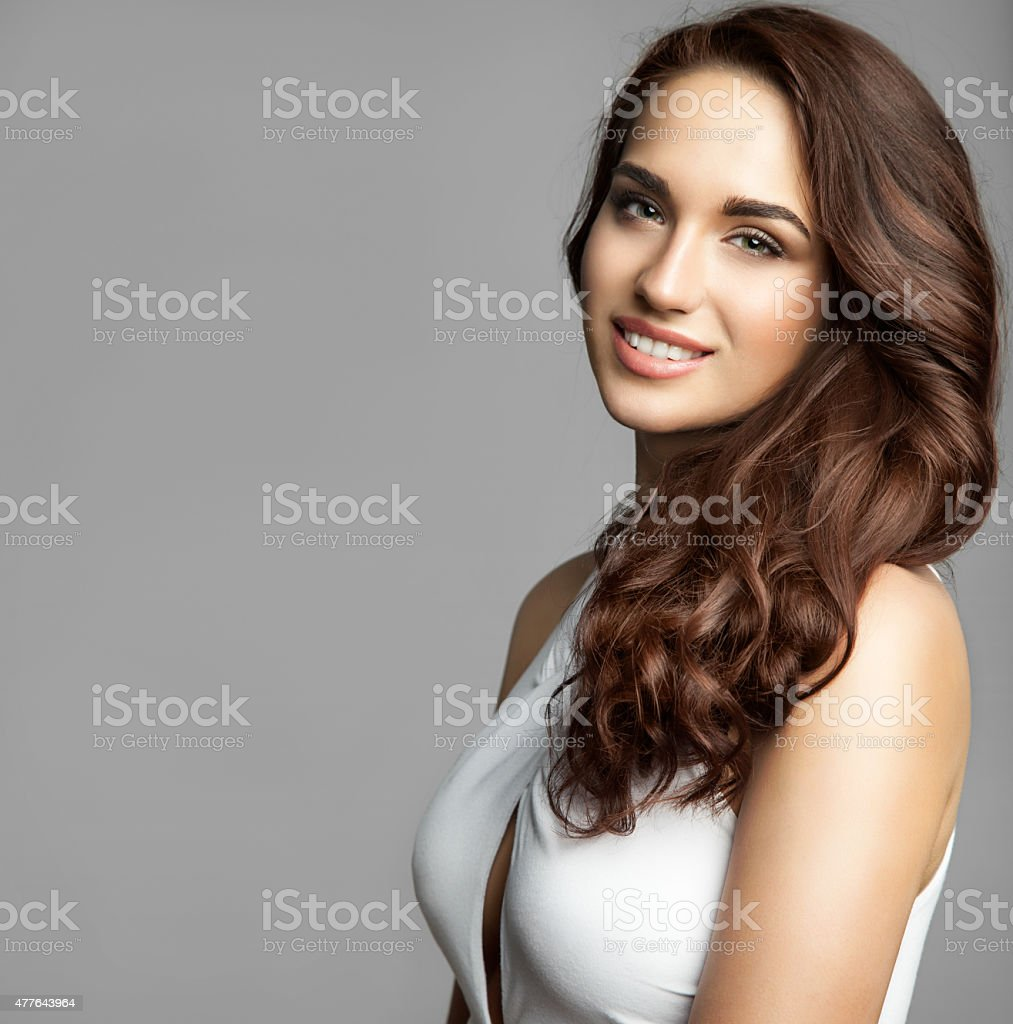 woman with a long thick curly hair stock photo