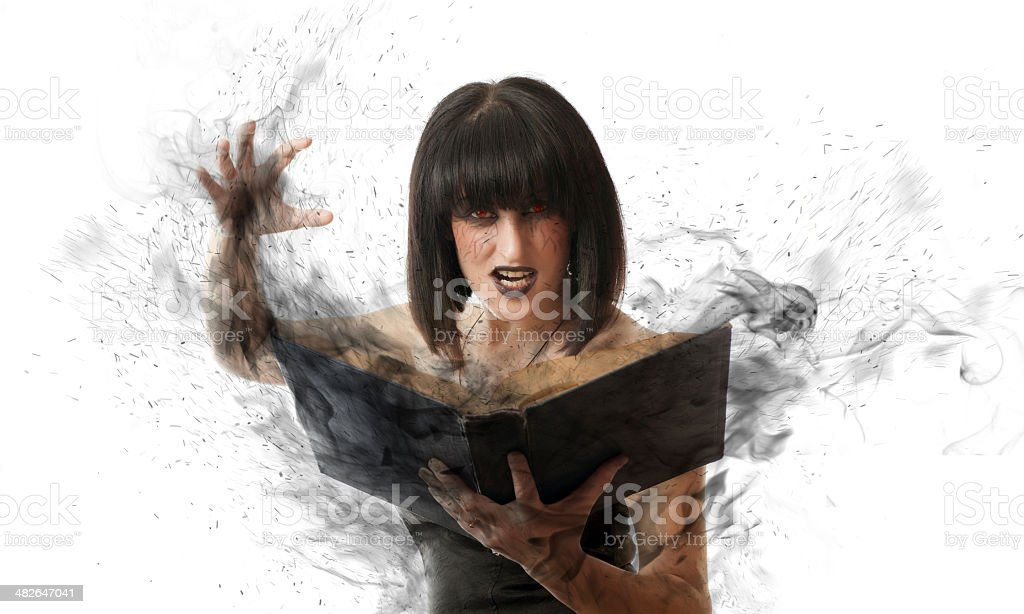 woman with a magic book royalty-free stock photo