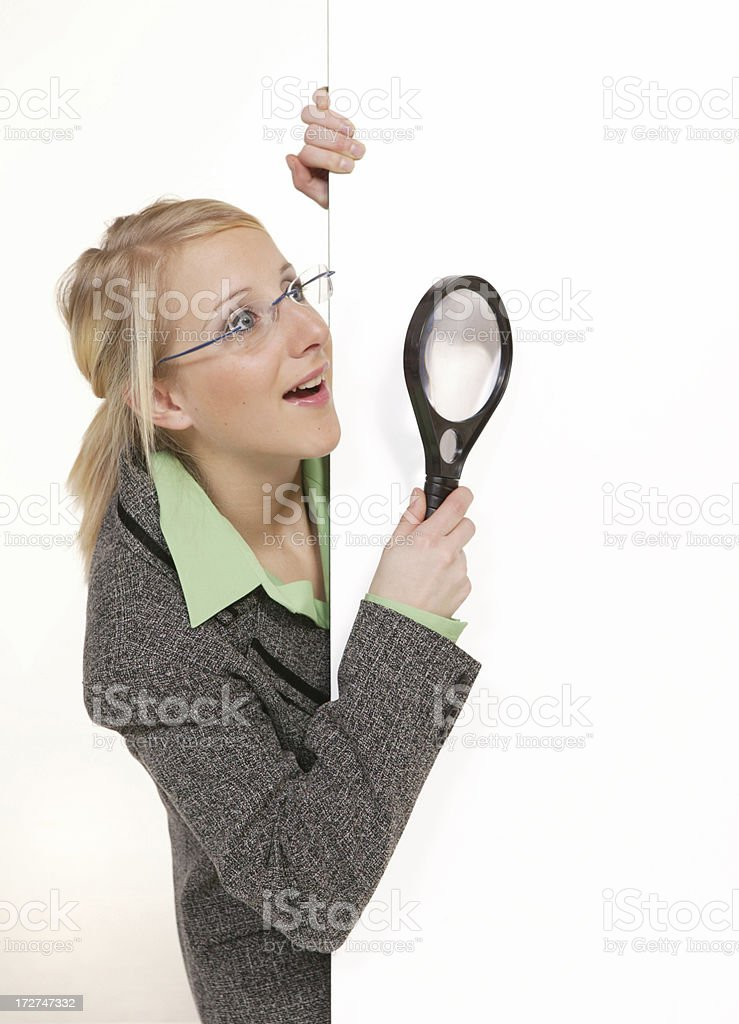 woman with a magnifying glass royalty-free stock photo