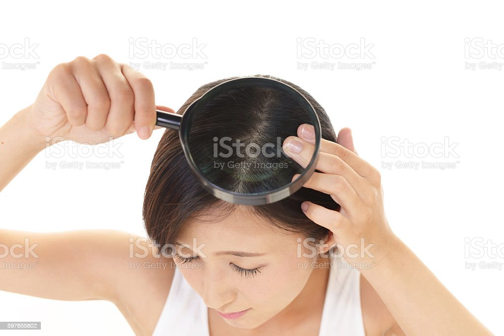 Woman with a magnifying glass stock photo