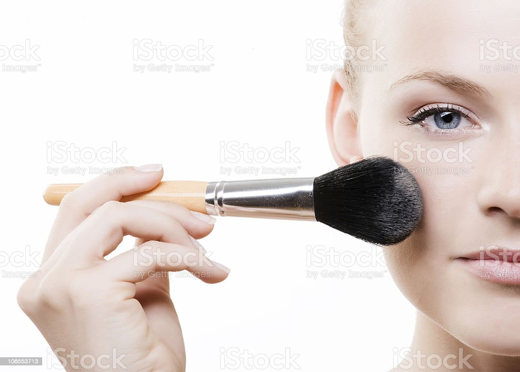 woman with a make-up brush royalty-free stock photo